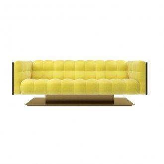 Elegante divano tre posti rivestito in tessuto o pelle, con struttura esterna in essenza lucida od opaca e base in metallo spazzolato. Della stessa collezione disponibili anche il quattro posti, il due posti e la poltrona.