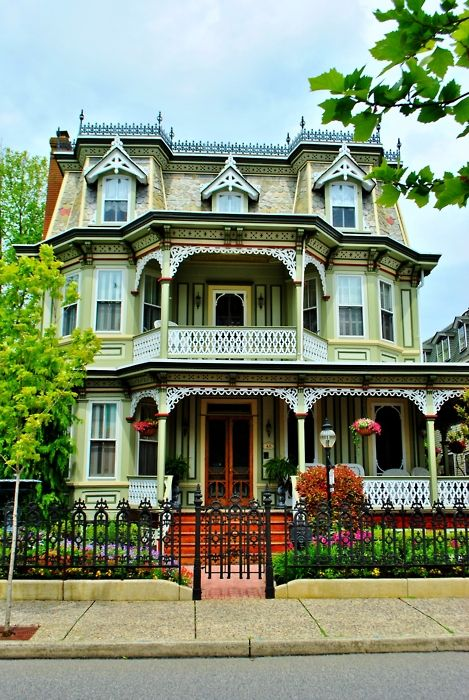 Another 'painted lady' ~ a Victorian masterpiece with Mansard roof and lots of gingerbread.  This restored beauty is enjoying new life.