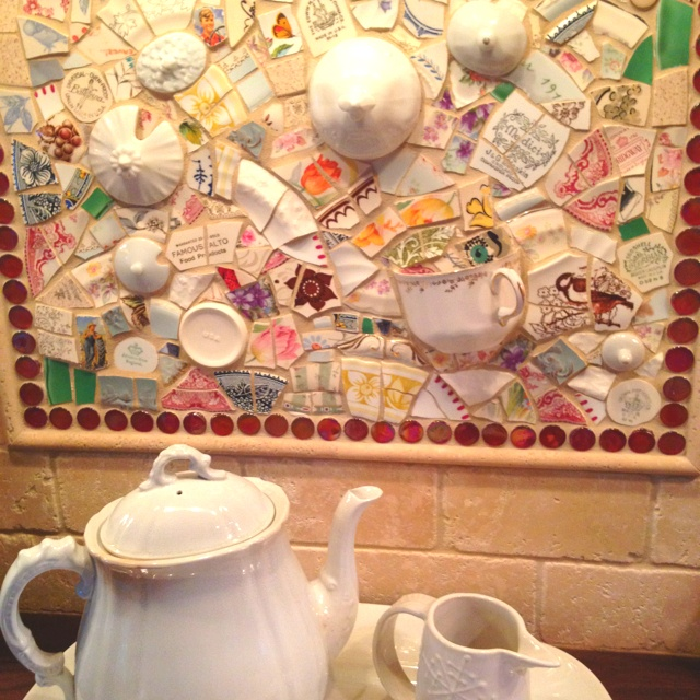 Teacup mosaic smaller pieces though and more handles and chunks maybe a blue/green theme with a white grout