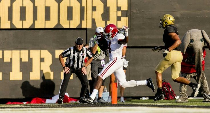 Alabama wide receiver Jerry Jeudy (4) scores on a pass fromAlabama quarterback Tua Tagovailoa (13) during the second half of the Alabama at Vanderbilt SEC football game, Saturday, Sept. 23, 2017, at Vanderbilt Stadium in Nashville, Tenn. Vasha Hunt/vhunt@al.com