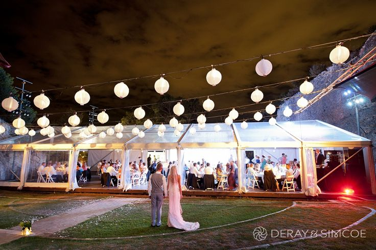 Indie bride and groom. White paper lanterns and a marquee. Wedding reception styling, ideas and inspiration.  Reception Venue: The Quarry Amphitheatre Photography by DeRay & Simcoe