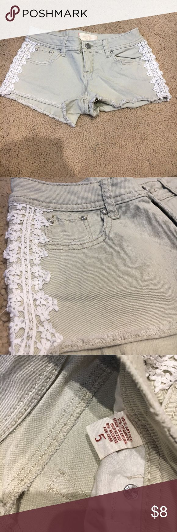 Kaki Jean Shorts Only wore once or twice, kaki jean shorts with a lace design going down the sides. In grear condition. Almost Famous Shorts Jean Shorts