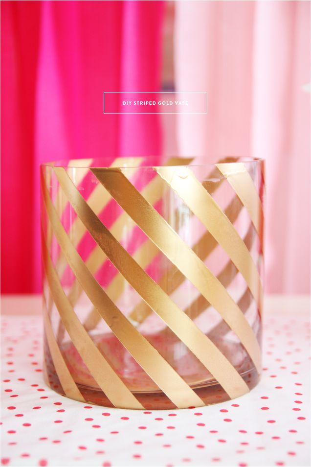 DIY striped gold vase.  Tape it off with washi tape & spray paint.  www.pencilshavingsstudio.com