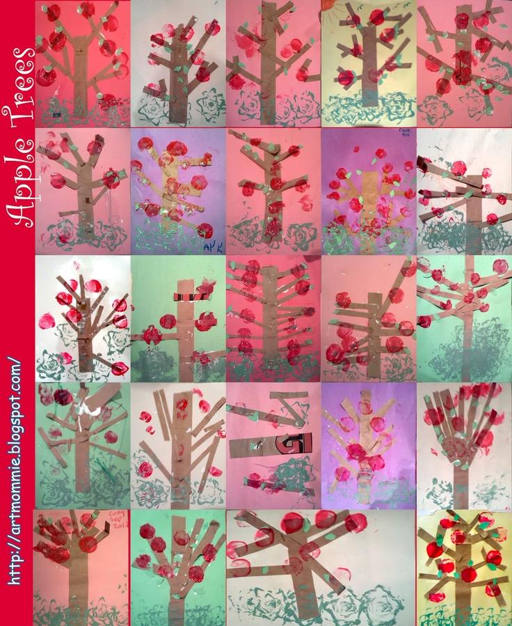 Appelboom kleven met stroken bruin papier, groene blaadjes en appels met kurkstempel