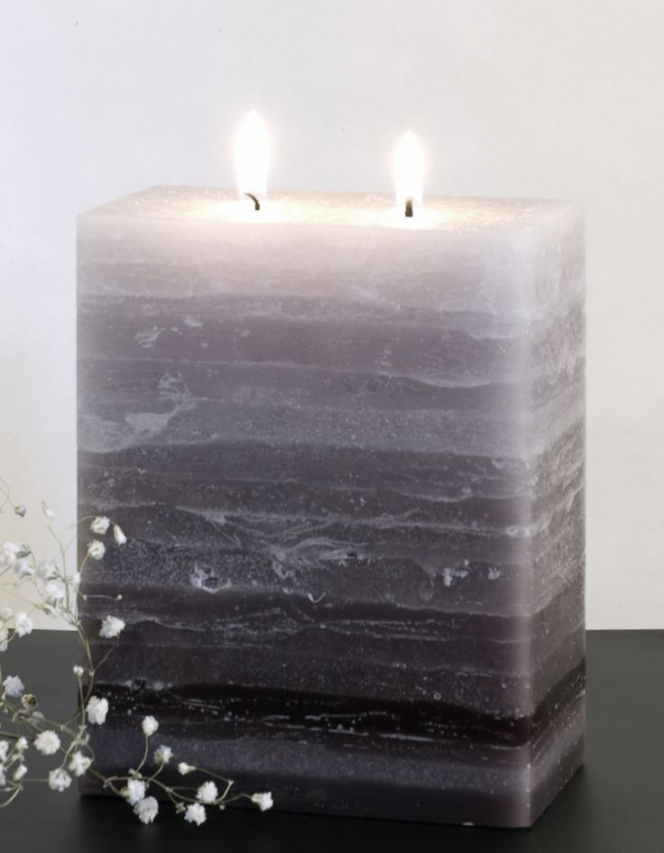 Layers of gray with a rustic surface. The candle has a rustic feel yet is uber modern. Certain to be an interesting, one of a kind, conversation piece in your home. Truly one of our favorites. Dimensi