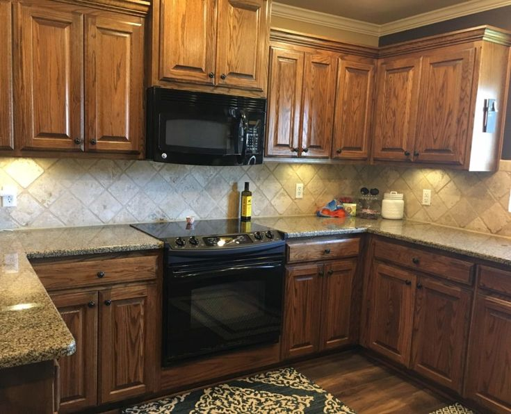should i paint my oak cabinets or keep them stained a