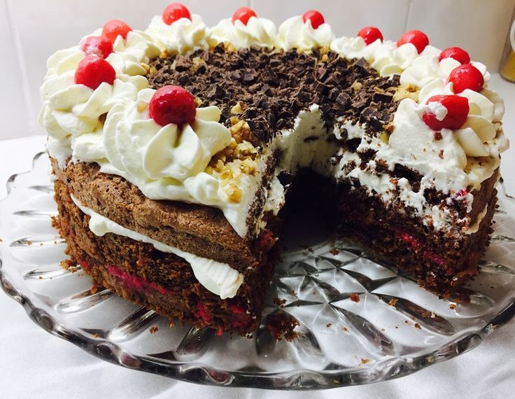 Chocolate nutcake with cherries and cream