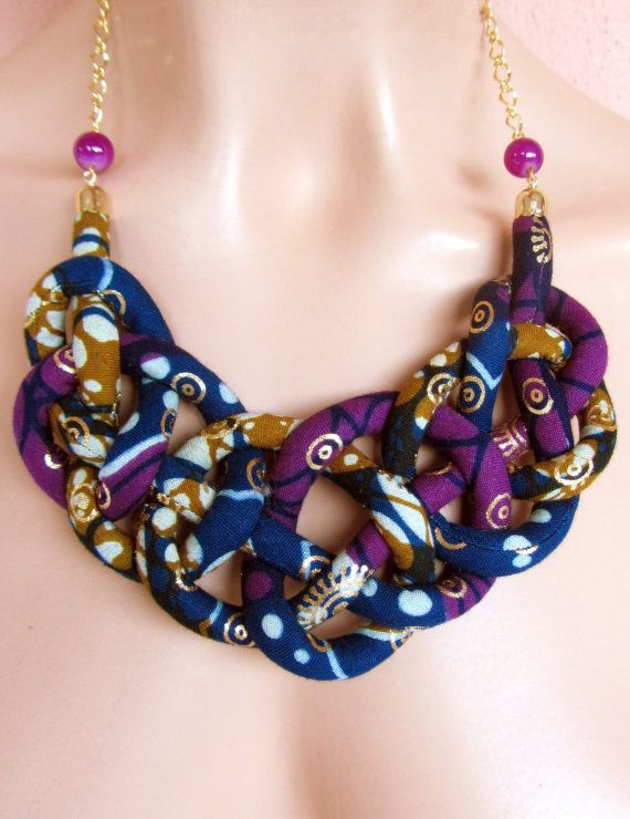 This gorgeous necklace is made out of one African wax fabric with golden metalic print tube of fabric that I sewed and fitted around synthetic wool.I have