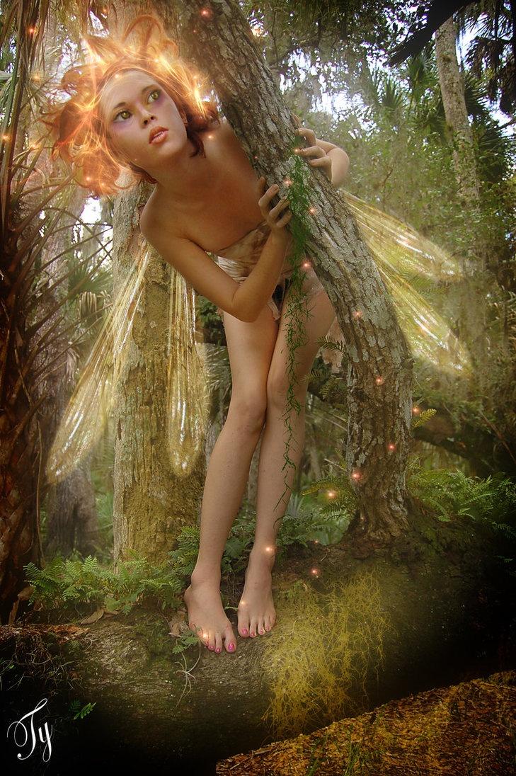 glowdwyn by tytaniafairy on deviantART  fairy peeking around a tree  Fairy Faerie Fae