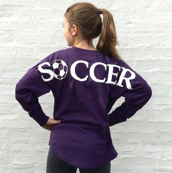 SOCCER Graphic Football Jersey Pullover is worn large, this phenomenally popular soft, yet durable thick cotton football jersey is stylish as it is unique. It features a unmistakable bold white puff print across the shoulders and athletic stripes.