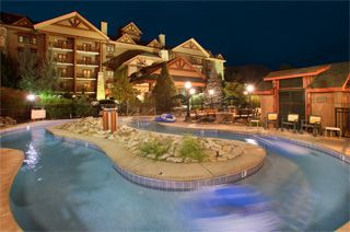 BEARSKIN LODGE ON THE RIVER Gatlinburg Hotel, right next to the Peddler