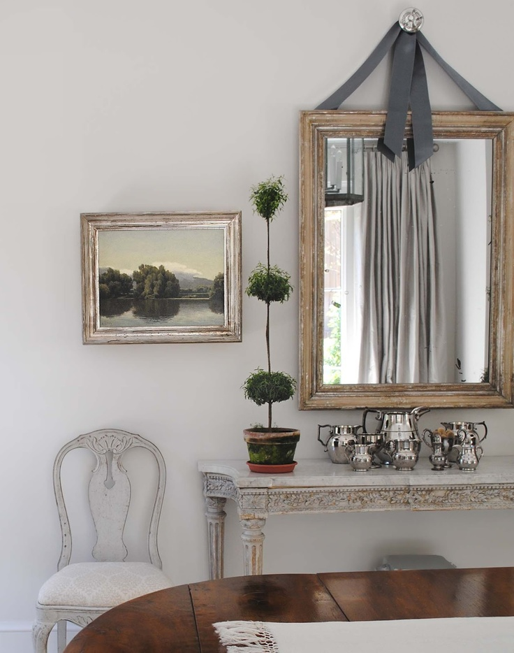 Loi Thai of Tone on Tone | love the way he hung the mirror with the ribbon