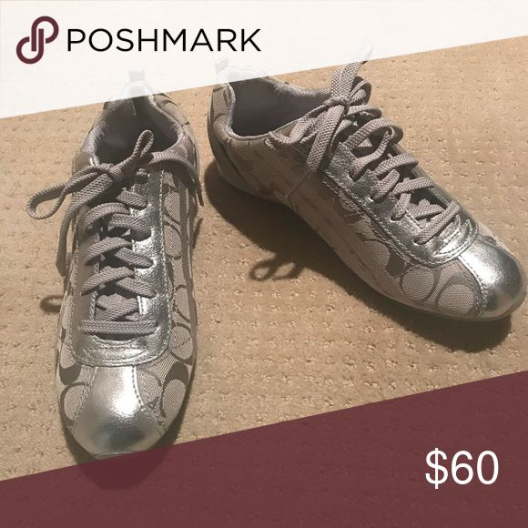 Silver coach tennis shoes Silver coach tennis shoes. Never worn! Coach Shoes Sneakers