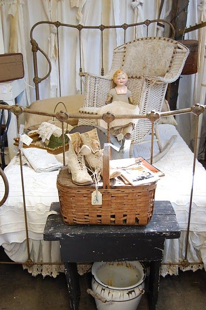 antiques are more fun to decorate with!  Love this look? - you can find old dolls, wicker, picnic baskets, primitive pieces and more at www.hendersonmemories.com