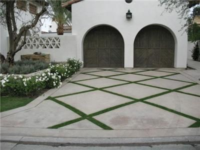 Concrete Driveway Design Ideas choose two types of patterns or finishes to give your driveway a unique look in this example exposed aggregate was used in the fields and a patterned Concrete Driveways Artcon Decorative Concrete Hamilton Mt Driveway Designdriveway Ideasdriveway