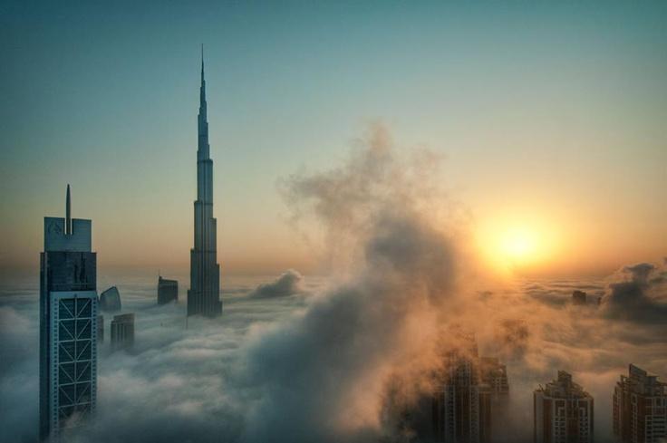 The Burj Khalifa rising above the clouds in Dubai UAE