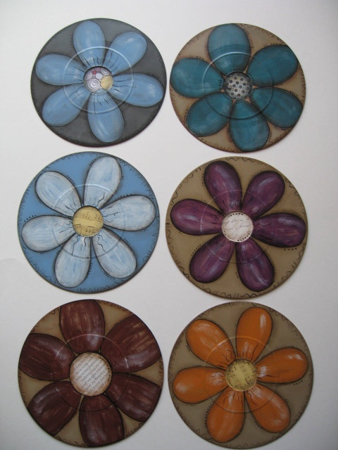 What to do with old 45 RPM records that aren't worth anything? PAINT them, of course! I just primed these, used specialty paper in the centers, and painted fun flowers on them!