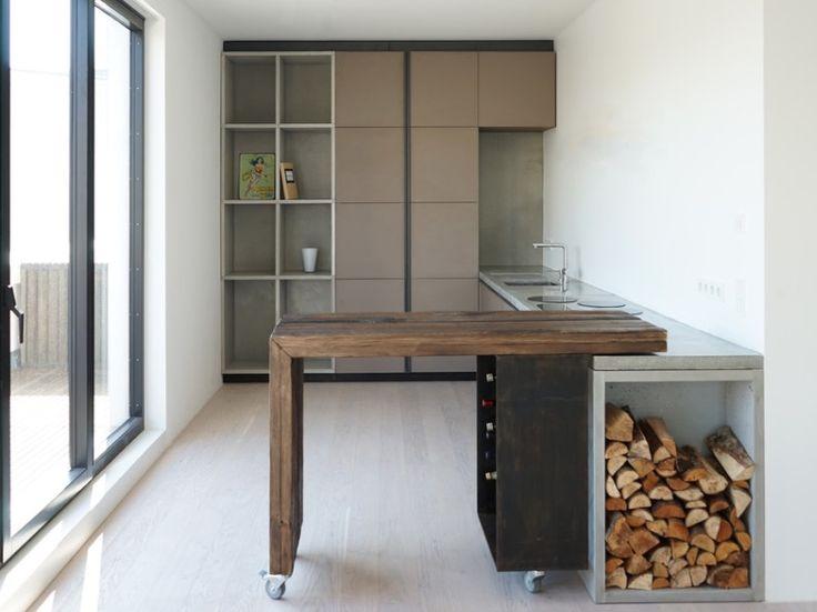 kitchen contemporary design of kitchen island has wheels that pivot island flush against wall. Black Bedroom Furniture Sets. Home Design Ideas