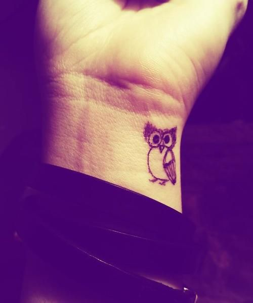 Cute owl wrist tattoo
