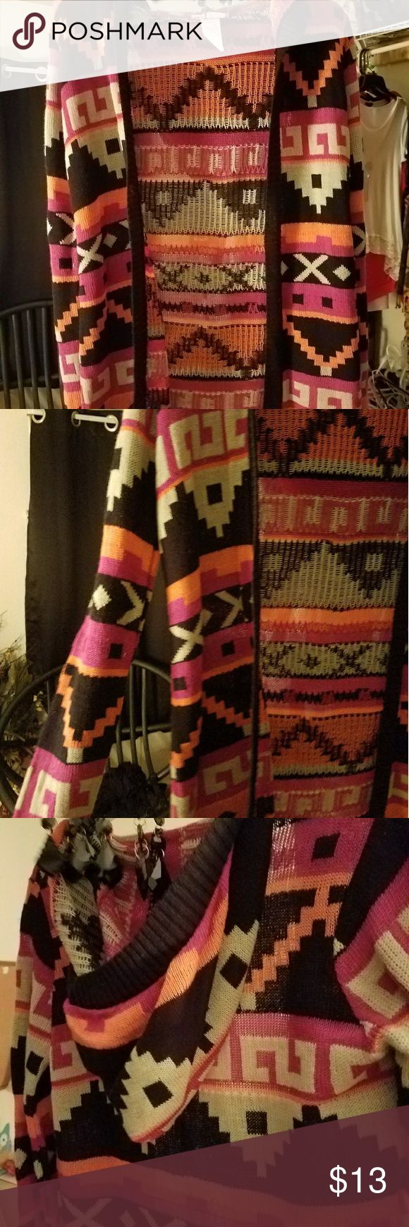 Hooded sweater cover up Tribal print hooded sweater cover up. Size m Never worn without tags too small Tops