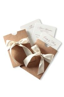 This new stationery design by Dragonfly Couture Stationery is spot on for country weddings. The classic script and luxurious satin bow gives it a traditional feel while with the recycled board pockets hint of a relaxed affair. Snap it up as shown or (BridesMagazine.co.uk)