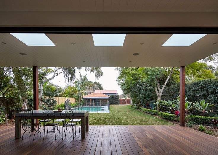 Deck with skylights and garden in Sydney Step Down House designed by Bijl Architecture