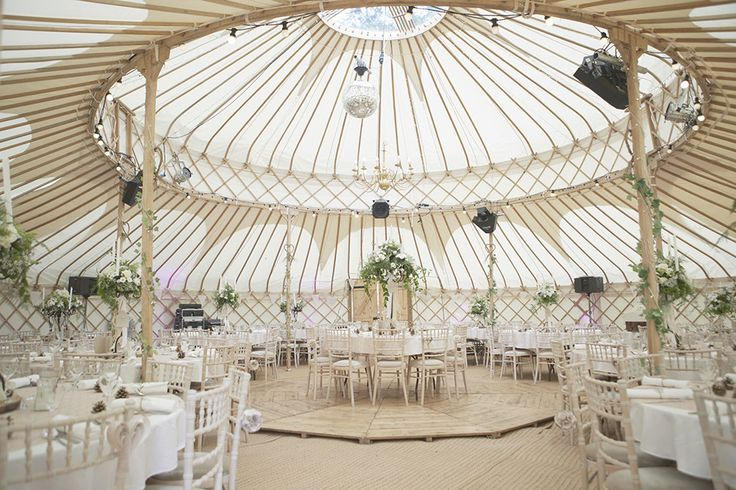 Wooden Lattice Framed Yurt - Image by Natalie J Weddings - Bride in an Amanda Wakeley Wedding Dress & Sigerson Morrison Shoes. Neutral twobirds Bridesmaid dresses &  Groom in a Reiss Suit for a stunning marquee reception.