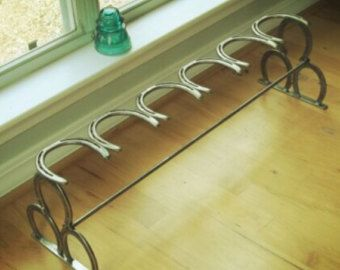 25 best ideas about horseshoe boot rack on pinterest for Things to make with old horseshoes