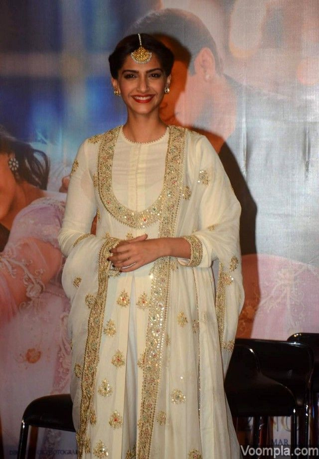 Sonam Kapoor wearing a traditional ensemble by designer Anamika Khanna paired with earrings from Sunita Kapoor's line and a ring by Anmol Jewellers. via Voompla.com