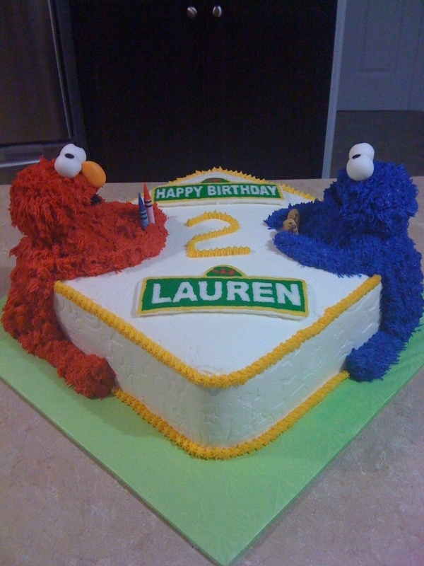 Adorable! Elmo and Cookie Monster birthday cake (buttercream)