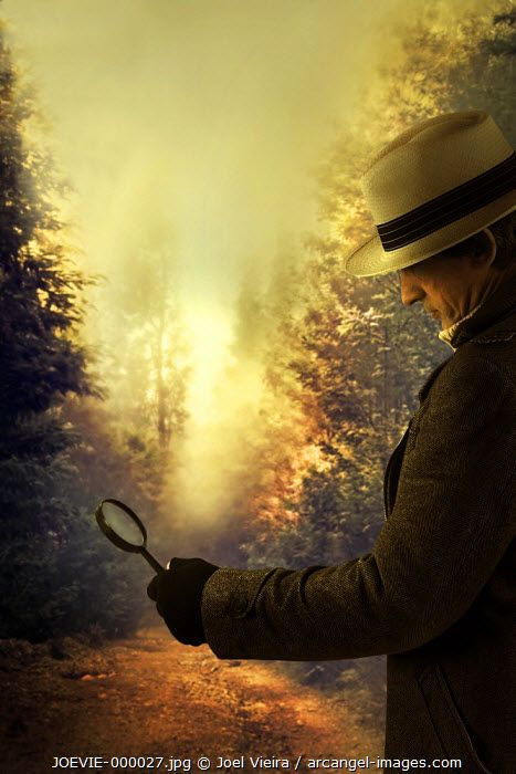 www.arcangel.com - detective-with-magnifying-glass-in-hand-on