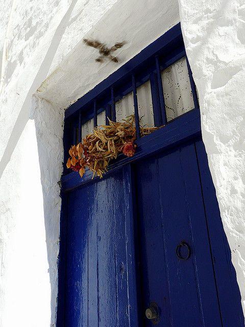 Protecting the House w/Easter candle cross burn in the doorway.  Blue door, Kimolos island, Greece