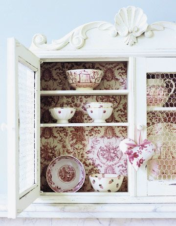 Wallpaper the inside of cabinets to make them lovely