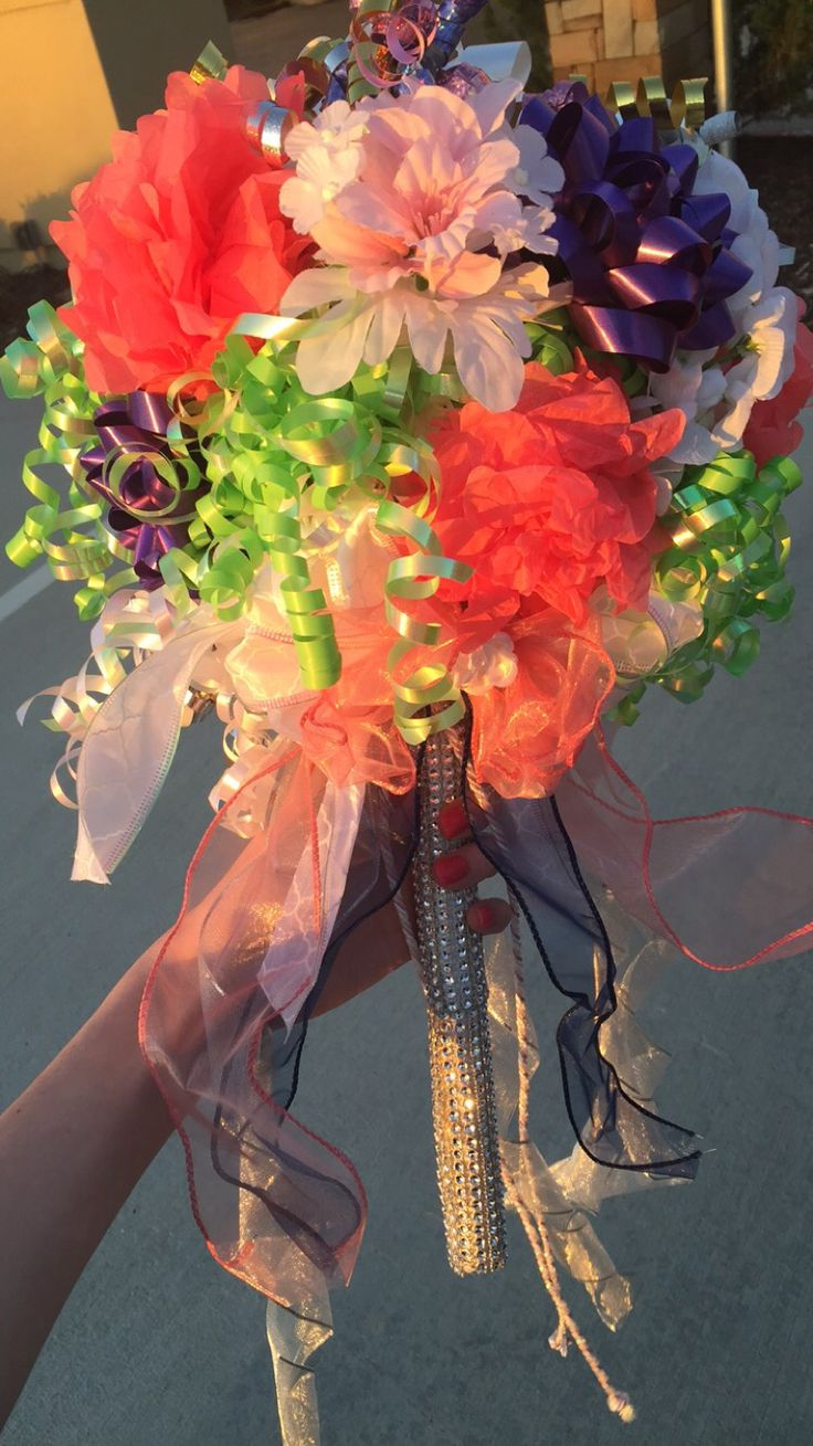 """Rehearsal dinner bouquet made out of bows/ribbons from wedding showers! all you need is a wooden dowel (I had to use a saw to cut mine because it was way too long), """"Darice bling"""" to wrap around the dowel, a styrofoam ball (the size is up to you- just use the dowel and twist it into the ball to make a hole and use hot glue to secure it) all purchased from hobby. And of course the bows/ribbons from the showers (hot glue to the ball) So much better than the paper plate bouquet"""