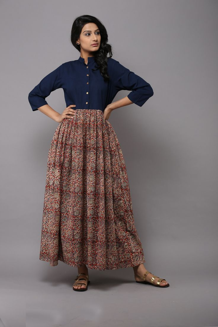 Description: Plain indigo yoke with a red kalamkari print gathered waistline in a soft mulmul fabric that gives a feminine touch without adding volume around th