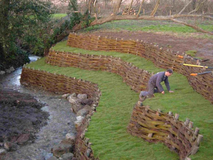 Willow spiling is the most common and best known green solution for bank revetment. The technique uses woven living willow to form flexible, live, growing structures which resist and deflect water flows, enabling the bank and vegetation to naturally re-generate and stabilize to prevent further erosion. > Wonder if this would work on our mountains of heavily weathered granite...