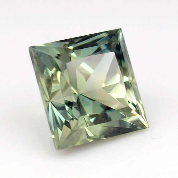 0.62 ct Genuine Australian Sapphire from Queensland. This natural, clean sapphire presents sparkling hues of green/yellow color. The Custom cut is of an