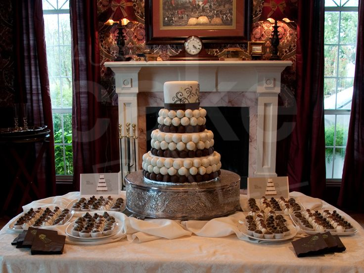 A Three Tier Cake Ball Wedding With Complementing Balls On Platters At North
