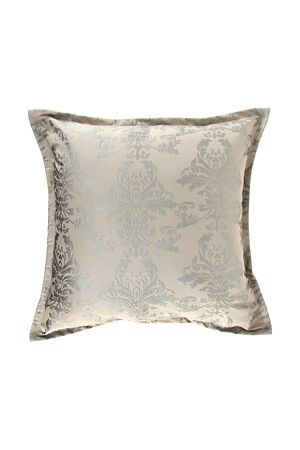 This large cushion has a jacquard woven paisley design. This cushion will add an opulent touch to your bedroom.