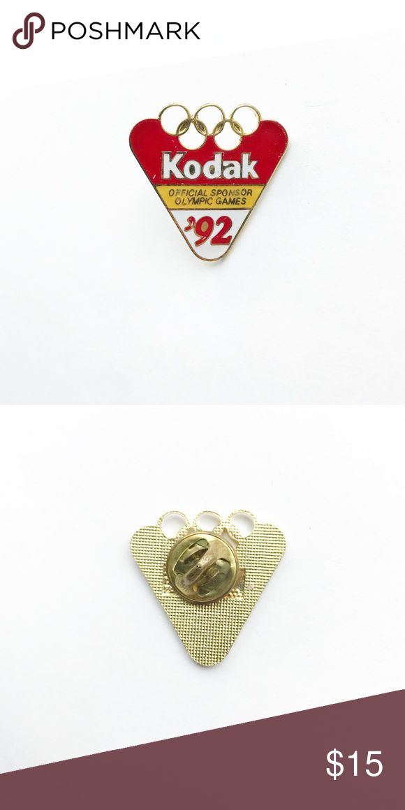 """'92 Olympic Games Enamel Pin 1992 Olympic Games Enamel Pin  • true vintage • 1"""" x 1"""" • colors: gold, white, red, yellow • tags: Kodak, Barcelona, Spain, France, official sponsor, sports, athletics, team, game, champions, winning, history, rings, building, 90s, nineties, swimming, sprinting, pole vaulting, volleyball, summer, winter, gold, silver, bronze medal, USA, America, hat, jacket, vest, lapel • all of the pins I sell are vintage and may contain minor nicks, imperfections, or oxidation…"""