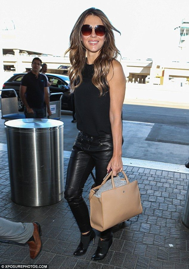 Leggy in leather: Liz seen here arriving at LAX ahead of the flight on Tuesday