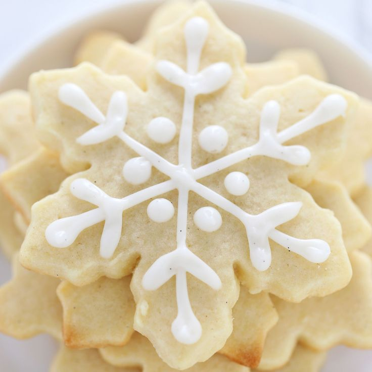 How to Make Easy Snowflake Sugar Cookies with time saving baking hacks and a full step-by-step video showing you how to decorate without royal icing!