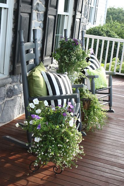 Front Porch- love the rocking chairs, striped pillows and planters! via StoneGable