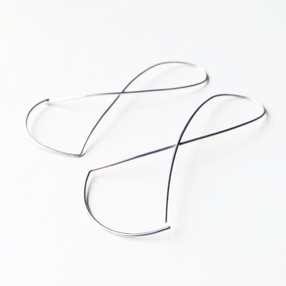 Endless unique geometrical earrings in silver by LauraEssayie