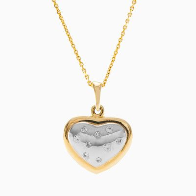 Fancy heart pendant, crafted in a combination of 14k yellow and white gold with crystals.