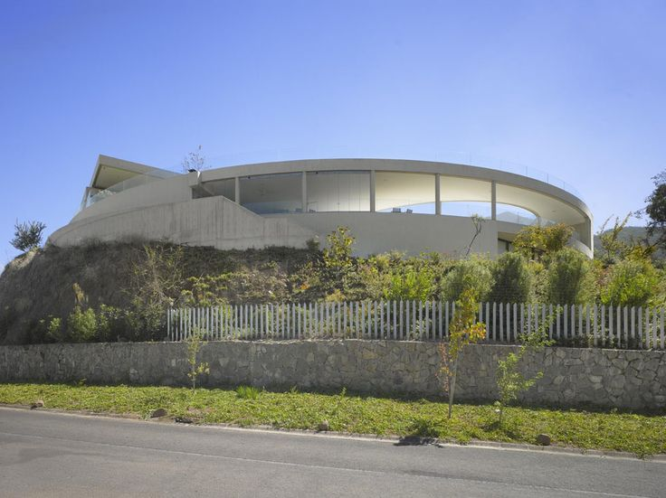 Unusual Family Residence Design Overlooking the Massive Andes in Chile  Read more: http://freshome.com/2014/07/17/unusual-family-residence-design-overlooking-the-massive-andes-in-chile/#ixzz3CSXK2Yn2