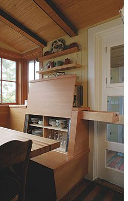 Amazing hidden storage within dining bench. Follow link to see appearance when closed (Arkin Tilt Architects)