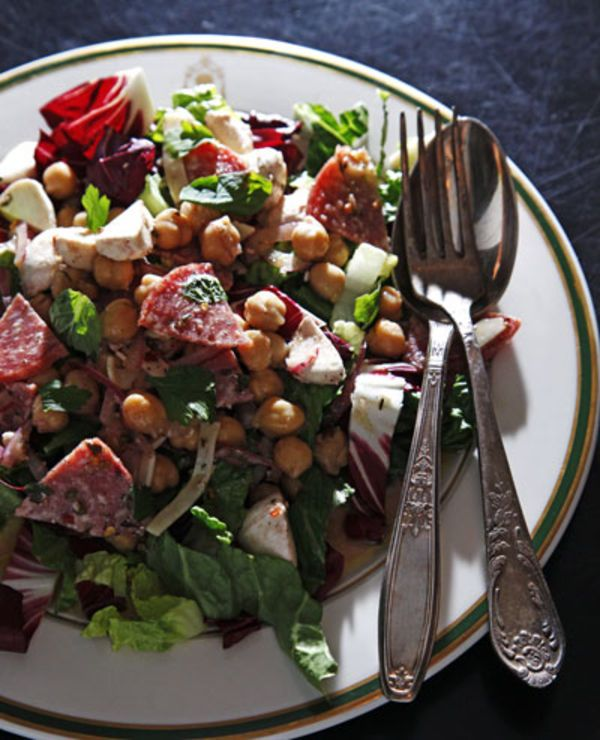Our take on the popular Leon Salad served at La Scala in Beverly Hills calls for marinating chickpeas, salami, and cheese in a red wine vinaigrette.