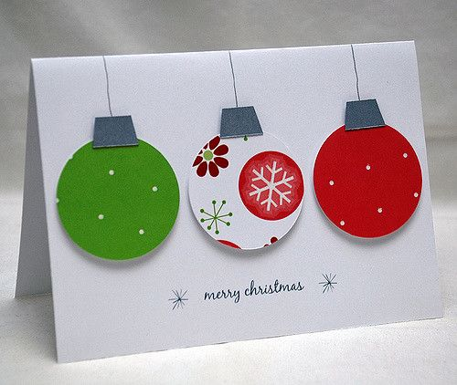 "Three glittery ornaments hang simply on the white background of this card. In more modern Christmas colors of lime green and a slightly pinkish red, each ornament has a bit of glittery embellishment and is adhered 3-dimensionally to stand out from the card giving it lots of depth. Two of the ornaments feature polka dots and the one in the center has decorative snowflakes and flowers. Each ornament is topped with a sparkling silver hanger and ""hung"" with hand-drawn silver ink. The w..."