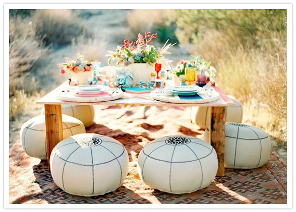 Moroccan Poufs add casual flair to an outdoor dinner party.